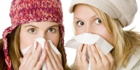 Two young wome cleaning their noses in winter - Армавирский Собеседник